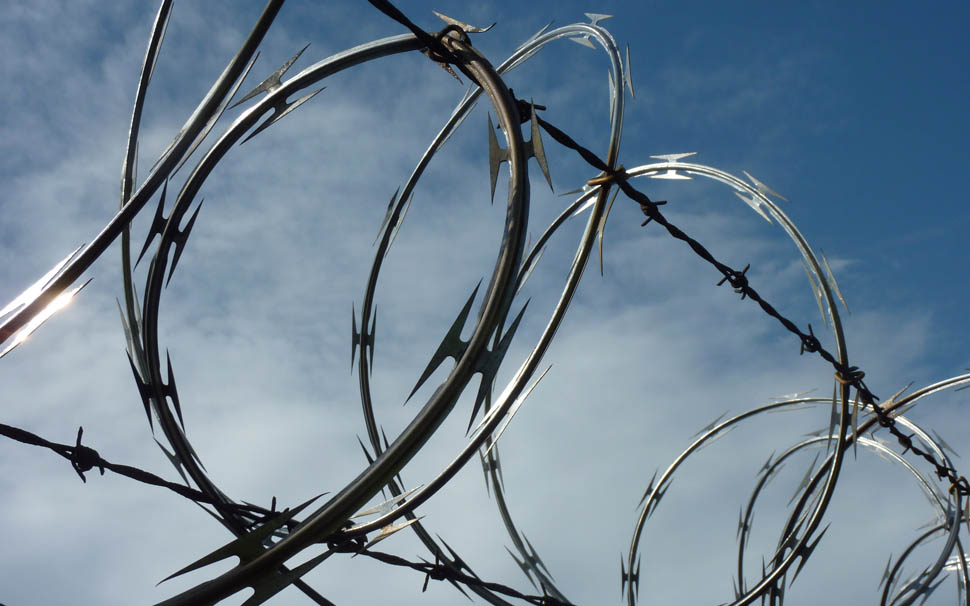 Our razor wire on customer's property